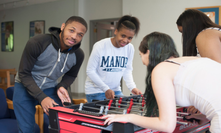 students playing games in residence hall at Manor College