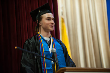 Thomas Hipwell addressing crowd at graduation
