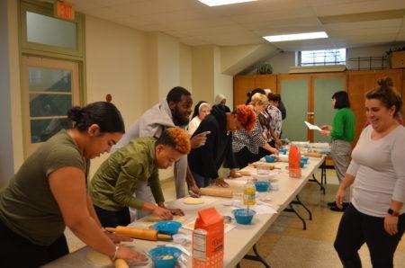 students bake bread together