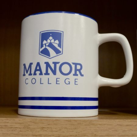 Manor College mug